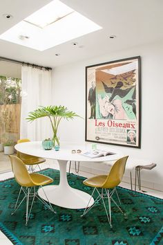 """Orlando made that bench and the pickle-colored fiberglass chairs are from <a href=""""http://modernica.net/eiffel-side-shell.html"""" target=""""_blank"""">Modernica</a>. The amazing hand-dyed rug is a <a href=""""http://www.rugsusa.com/rugsusa/rugs/vendimia-rugs-klm566/teal/200ABSKLM566-67097.html"""" target=""""_blank"""">one-of-a-kind masterpiece</a>"""