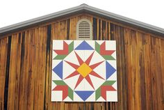 """( Barbara Haddock Taylor, Baltimore Sun / October 11, 2011 )  This is the """"Summer Star Flower"""" quilt pattern, which is painted on a barn on Marnardier Ridge Road in Grantsville. It's one of the stops along the Barn Quilt Tour."""