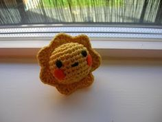 I crocheted a tiny sun with an orange blush.      But now that I look at these pictures, she looks like Pikachu.   It's a sun, I swear! Look...