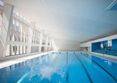 Paris swimming pool refurbishment features blue bleachers