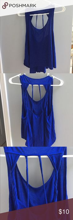 Super cute back cut out tank top. Worn once. Dark blue high low tank top. The back is open and cut low. Very cute. I apologize for the wrinkles but it has been in a box. Bozzolo Tops Tank Tops