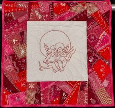 Angel Babies with Embroidery by Donna McDade.  NQA 2014 Quilt Show Winner
