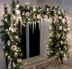 pick a holiday color palette and stick to it while decorating your bathroom for the season, like the green, white, and silver garland hanging from this bathroom vanity mirror... Changing Seasons: Easy Winter Holiday Bathroom Decor from Bathroom Bliss by Rotator Rod