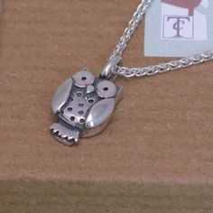 This little owl is a lovely weight andmeasures from top of loop to feet and across body. He hangs on a fluid silver spiga chain measuring 18 inches in length and has little spots on his tummy Owl Pendant, Pendant Necklace, Little Owl, Temple Jewellery, Playing Dress Up, Precious Metals, Owls, Bling, Gemstones