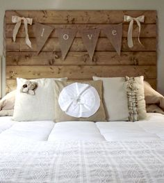 reclaimed wood headboard -- but I would definitely stain it before and connect them rather than nail straight to the wall