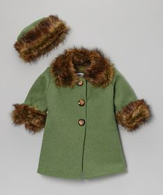 green fur jacket with matching hat, I love it