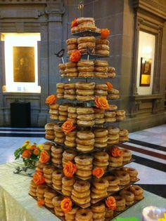It's a donut cake for a wedding. signatureeventsbybarbie.com