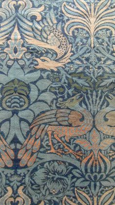 Detail: Arts & Crafts woven wool wall hanging depicting peacocks and dragon designed by William Morris and originally manufactured in Queens Square. It was woven on a hand loom and this design was based on Sicilian silk weaves dated form the 15th and 16th centuries. Morris & Co. Length 268cm x Width 153 cm Circa 1878