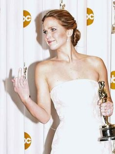 When she flipped off everyone while holding an Oscar and we still bowed down: | 51 Times In 2013 Jennifer Lawrence Proved She Was Master Of The Universe