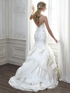 Fit and flare with Venice organza and a romantic sweetheart neckline