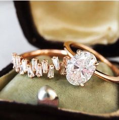 Baguette diamond band and oval engagement ring. Trabert Goldsmiths