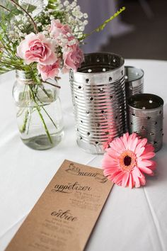 centerpiece with repurposed tin cans used for candles