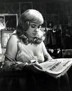 Shirley Jones reading.    Jones (born 1934) has starred in a number of musical films, such as Oklahoma! (1955), Carousel (1956), and The Music Man (1962). She won the Academy Award for Best Supporting Actress for playing a vengeful prostitute in Elmer Gantry (1960). She played Shirley Partridge, the widowed mother of five children in the television series The Partridge Family (1970–1974).