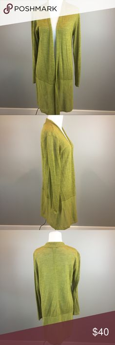 "Eileen Fisher Olive Green Wool Open Long Cardigan Woman's Eileen Fisher long sleeved olive green wool open thin Knit long cardigan sweater, size Med. Measurements: Armpit to armpit laying flat 19"" Length from top of shoulder to bottom of cardigan 38"" Comes from a smoke free home Eileen Fisher Sweaters Cardigans"