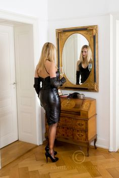 Tight Black Leather Dress With Visible Garter Bumps Black Leather Gloves Sheer Black Back Seam Stockings and Black Stiletto High Heels