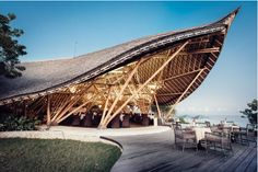 Situated amidst Indonesia's premier surf breaks along Bali's iconic southern peninsula, Suarga Padang Padang is a Bali sustainable boutique resort. Timber Architecture, Tropical Architecture, Futuristic Architecture, Architecture Design, Beautiful Architecture, Padang, Design Hotel, Bamboo House Design, Bamboo Building