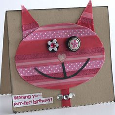 Embellish Your Paper Piecings with Texture  Design by Cathy Blackstone  Cathy embellished her pink cat with scraps of pink ribbon, a gem collar, buttons, and brads to give her piece a whimsical personality.  Editor's Tip: It's easier to trace and cut a design from ribbon-covered cardstock by working on the back. Just remember you may need to flip your pattern over.
