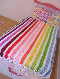 Use really thick yarn and a big hook. Between each color do a row of black or white in a different stitch from the colored rows.