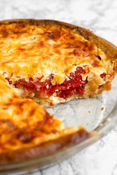 Tomato Pie features fresh Jersey tomatoes, Greek Yogurt, and sharp cheddar cheese. DROOL.
