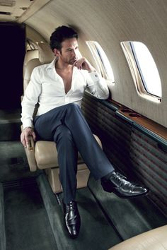 Le voyageur. Who needs a suit or a tie when you've got a private jet? .//. love the unbuttoned white shirt
