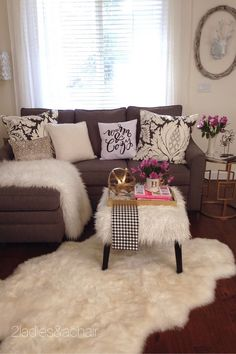 To decorate a small room with warmth and depth, use layers of different textures. Love the faux fur throws and rug and the colorful pillows!