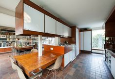 1960s John Winter-designed grade II-listed modernist property in London N6 - this house is all lovely open layouts. I love the upstairs living space and office divided but still open.