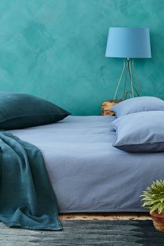 Blue on blue makes a calm, but incredibly impactful, bedroom statement.