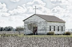 church in a cotton field. Looks like the Mississippi Delta to me.