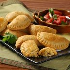 Baked Chicken Empanadas - Costa Ricans make exceptional empanadas, a dish introduced to them by the Spanish. This savory chicken and cheese version is a great way to use up leftover cooked chicken. For best results, do not overfill the empanadas or the dough may tear. If you enjoy empanadas and make them often, an empanada mold is a worthwhile gadget that turns them out quickly and easily.