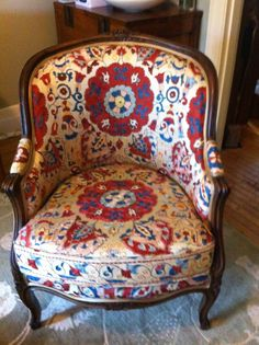 French Oak Bergere chair covered in a hand embroidered silk on silk suzani
