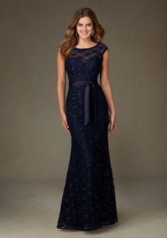 Spectacular Long Beaded Lace Bridesmaid Dress Designed by Madeline Gardner. Matching Tie Sash included. Shown in Navy.