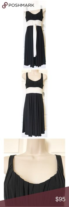 NEW Nine West Night Out in Paris Dress,Black/Ivory This is a gorgeous, new with tags dress from Nine West!  It is called Night Out in Paris and you can see why - it is pure elegance!  It has a beautiful, pleated scoop neckline and an attached ivory/off-white sash that you can tie either in front or back - I have shown it both ways in the photos.  It has a hidden side zip, it falls below the knees, and the fabric has beautiful swing. Nine West Dresses Midi