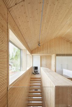 Teemu Hirvilammi has completed a wooden house for his own family in Finland, featuring dark external walls that contrast with a pale wood interior Architecture Design, Timber Architecture, Pole Barn House Plans, Pole Barn Homes, Barn Plans, Arch House, Espace Design, Wooden Buildings, Interior Stairs