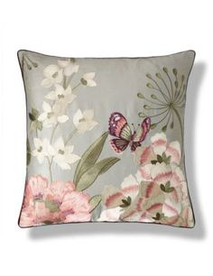 Stylish and comfortable, this luxurious cushion has a real feather filling and a glamorous embroidered floral design.