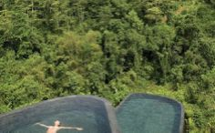The infinity swimming pool at Ubud Hanging Gardens is perched over a rain forest in Bali. The pool stands on 2 levels surrounded by sun beds. In addition to the main pool, all rooms and suites have a pool for guests looking for a more private atmosphere. Ubud Resort, Ubud Hotels, Places To Travel, Places To See, The Places Youll Go, Hanging Gardens Bali, Places Around The World, Around The Worlds, Infinity Pools