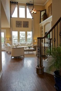 traditional model home - 2 story window treatments. Interesting placement of the tie backs.