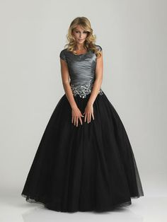 Night Moves Modest Prom - 6808M  Night Moves Modest Prom      Ball gown with ruched bodice and sequin applique accenting the dropped waistline. Full, tulle skirt.