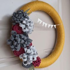 A full view of my first felt-flower wreath! I like the fact these color combinations can work all year-round😊   #yearroundwreath #doordecor  #frontdoor  #yarnwreath  #wreath   #feltflowers   #felt   #TheFancyDinosaur  #handmade
