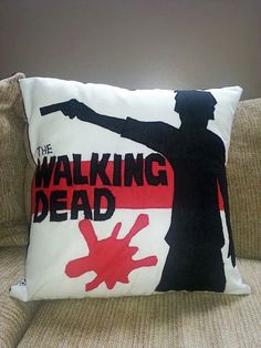This pillow was created for a friend of a friend who loves watching The Walking Dead. I was given a poster image from the tv show and came up with this idea for the pillow. I also added a blood splatter!