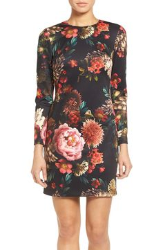 Swooning over this floral printed shift dress in rich-colors. Pair with pumps and a statement necklace for a chic look.