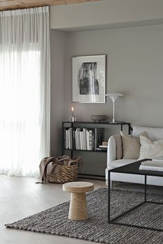 Soft grey walls and diffused light in a minimalist living room. Love the thin framed black shelving unit and how it connects with the thin framed square coffee table. wall Beige and grey in the living room Minimalist Living Room, Minimalist Living, Living Decor, Rustic Living Room, Living Room Lighting, Beige Living Rooms, Living Room Diy, Lamps Living Room, Living Room Grey
