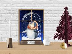 The little penguin in a snowglobe wishes everyone a Merry Winter (the rest is just a mockup to show how the print looks on a table