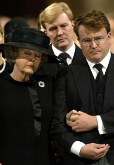 Prince Friso of the Netherlands comforts his mother, Queen Beatrix at the funeral of her husband and his father, Claus.
