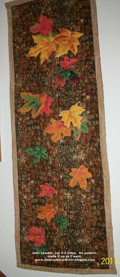 Wall hanging made years ago.  A fall piece using fussy cut leaves from fabric and then some leaves are soft 3-D.  I've since learned a better way to make 3-D leaves, flowers.  www.jloscreativecorner.blogspot.com