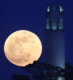 The May's full moon rises beside San Francisco Coit Tower in San Francisco on Saturday, May 5, 2012. (Frederic Larson, San Francisco Chronicle/AP Photo)