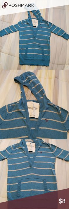 Abercrombie girls 3/4 hooded sweater sz Large Gently worn, cute light weight hooded sweater by Abercrombie girls size Large (similar sizing as A&F women's XS). 3/4 sleeve, baby blue with gray stripes and a kangaroo pocket. No rips, stains or fading. Great for layering on top of a tank top. Can be dressed up or down.  Check out my other listings & make a bundle to save even more $$ on shipping and 10% off 3+ items!! Abercombie Kids Shirts & Tops Sweaters