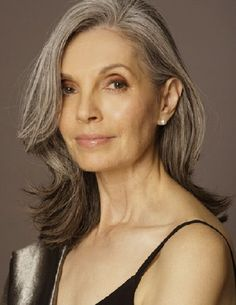 Nola Baxter...stunning. When I see women with grey hair like this, I just have to tell them how beautiful it is. I haven't dyed my hair in almost 10 years, and I love my greys, can't wait to earn more .