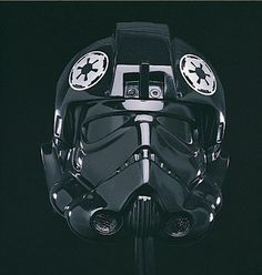 The one-piece TIE Fighter Pilot helmet is made of rotocast vinyl and finished in high-gloss black.