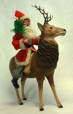 Antique German Paper Mache Santa on Reindeer Candy Container c1910. NIN $1800. 5/14
