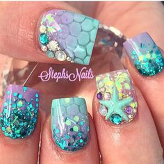 This nail design remind me of Princess Arial from the Disney Classic movie, 'The Little Mermaid'!